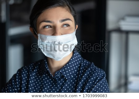 Stock photo: Smiling happy woman in mask.