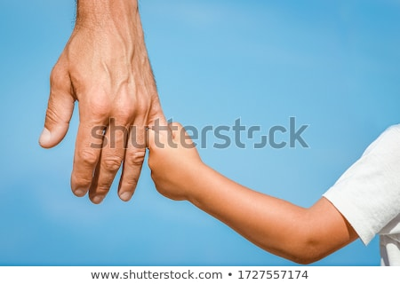 silhouette of two happy adults and a child stock photo © dashapetrenko