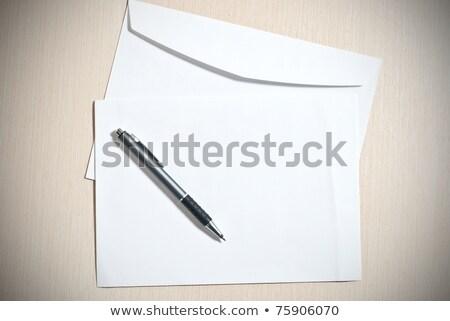 Foto stock: Dois · branco · lápis · caneta · fundo · tabela