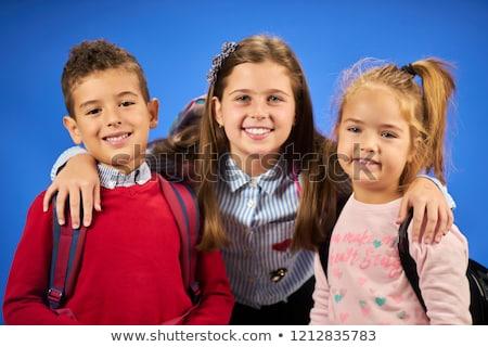 Cute элементарный улыбаясь камеры белый школы Сток-фото © wavebreak_media