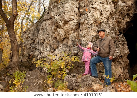 The grandfather and grand daughter are near the cavern Stock photo © Paha_L