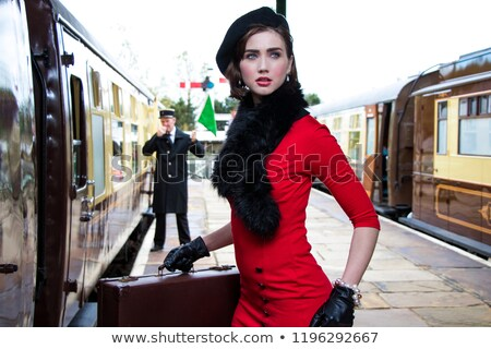 attractive woman in red dress of retro style stock photo © aikon