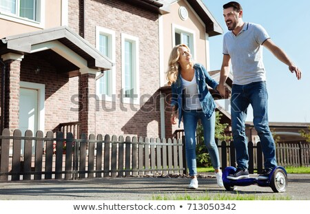Laughing man holding hoverboard Stock photo © ozgur
