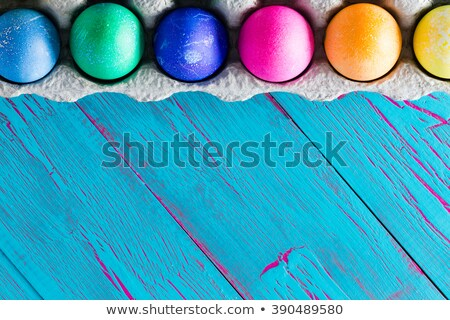 colorful easter egg frame on exotic blue copyspace stock photo © ozgur