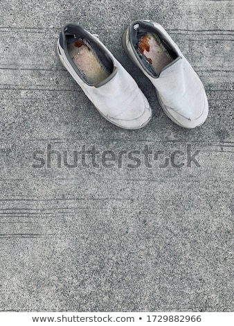 Stock photo: Casual Canvas Shoes On Concrete Road