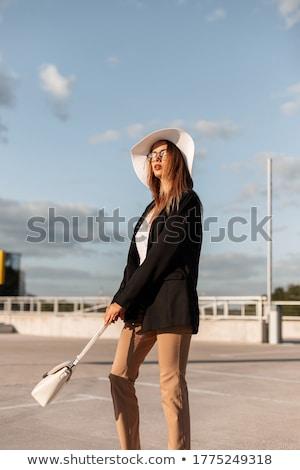 Сток-фото: элегантный · женщину · позируют · красивая · женщина · долго · вьющиеся · волосы