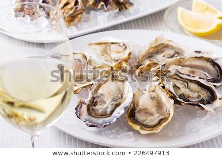 Friss osztriga fehérbor felszolgált jég étel Stock fotó © artjazz