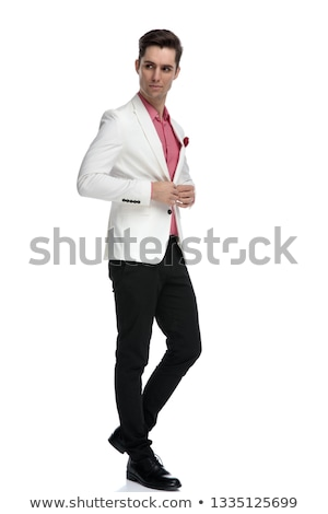 business man buttoning his suit and looks over his shoulder stock photo © feedough