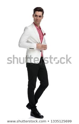 Hombre de negocios traje hombro sentado estudio Foto stock © feedough