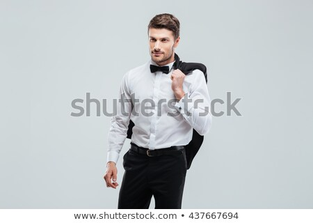 cool young man in tuxedo and bowtie posing Stock photo © feedough
