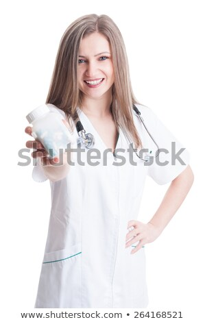Stock photo: Female doctor holding unlabeled bottle of various pills and medi