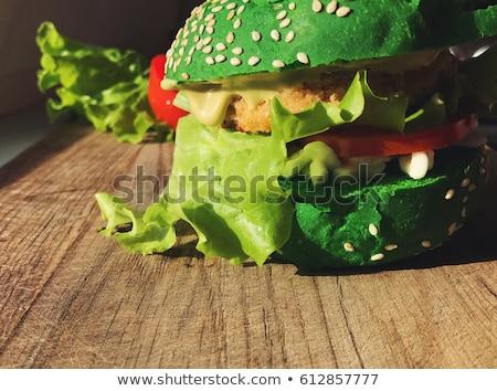 Exotic green burger in bun with sesame seeds tomato lettuce Stock photo © softulka