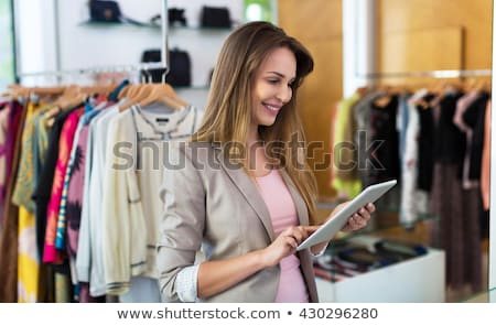 Woman with tablet in tailor's shop Stock photo © dash