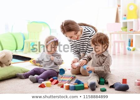 Baby sitting indoors Stock photo © monkey_business
