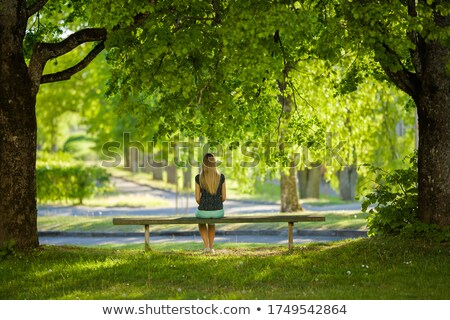 lonely young woman sitting daydreaming stock photo © giulio_fornasar