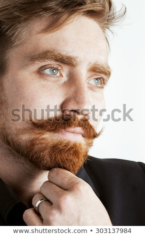 Fiatal vörös haj férfi szakáll bajusz fekete öltöny Stock fotó © iordani