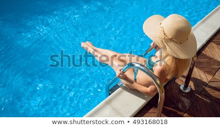 Underwater view of woman in pool Stock photo © IS2