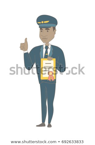 Young african-american pilot holding certificate. Stock photo © RAStudio