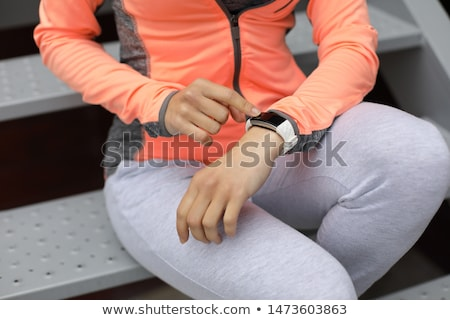 Stock photo: close up of sporty woman with fitness tracker