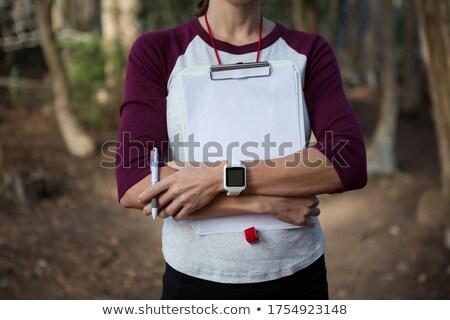 Mujer manos escrito armas forestales Foto stock © wavebreak_media