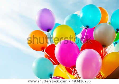 Stock photo: Balloons with Streamers in a Blue Sky