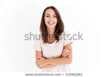 Pleased brunette woman in shirt with crossed arms looking aside Stock photo © deandrobot