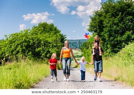 Young couple walking down rural road Stock photo © IS2
