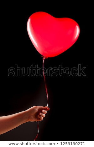 Red birthday balloons soaring in air Stock photo © LoopAll