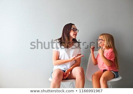 Dühös fiatal anya megbeszélés kicsi lánygyermek Stock fotó © dashapetrenko
