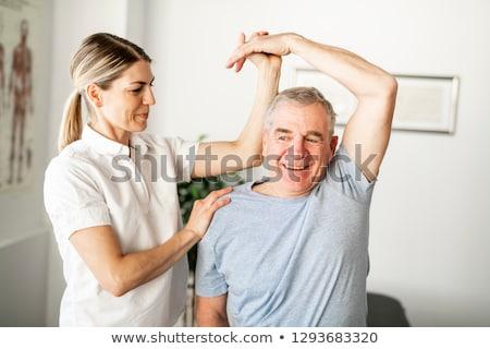 Erkek terapist bacak el kadın Stok fotoğraf © AndreyPopov
