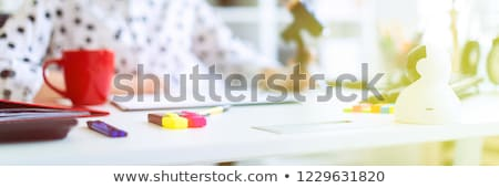 Girl in the office with markers and calculator. A photograph with a depth of sharpness, a highlighte Stock photo © Traimak