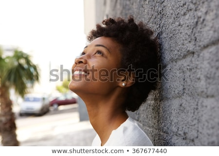 Contemplating young woman looking up Stock photo © Kzenon