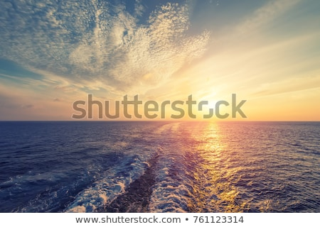 blue sea water waves sunset from ship wake stock photo © lunamarina