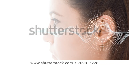 Primer plano oído audífono mujer escuchar Foto stock © AndreyPopov
