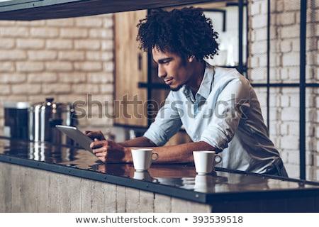 üzletember tabletta kávéház számítógép kávé divat Stock fotó © Minervastock