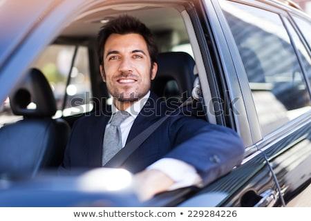 Retrato bonito sorridente homem de negócios condução carro Foto stock © Minervastock
