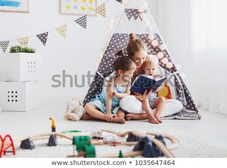 Vidám fiú olvas könyv gyerekek sátor otthon Stock fotó © dolgachov