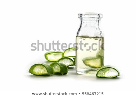 Slices of a aloe vera leaf and a bottle with transparent gel for medicinal purposes, skin treatment  Stock photo © galitskaya