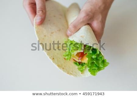 Człowiek tortilla przekąski meksykańskie jedzenie food stroną kucharz Zdjęcia stock © mythja