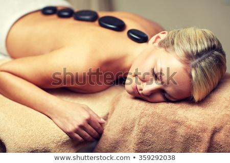 Foto d'archivio: Close Up Of Woman Having Hot Stone Massage In Spa