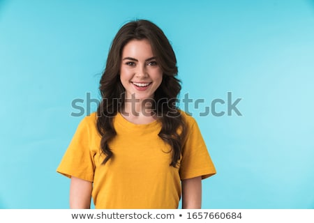 Happy pretty woman posing isolated over blue wall background with orange citrus. Stock photo © deandrobot