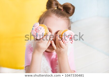 Pretty Girl Looking At Cupcake Stock photo © AndreyPopov