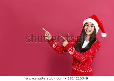smiling girl in santa hat with christmas gift stock photo © dolgachov