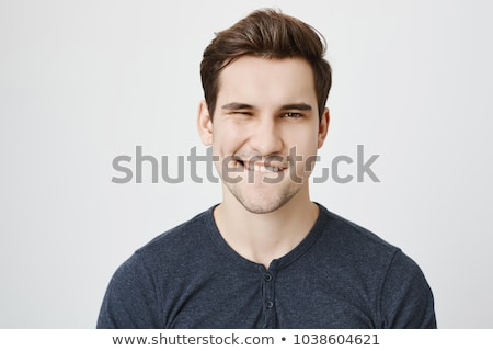 young attractive man biting his lip stock photo © feedough