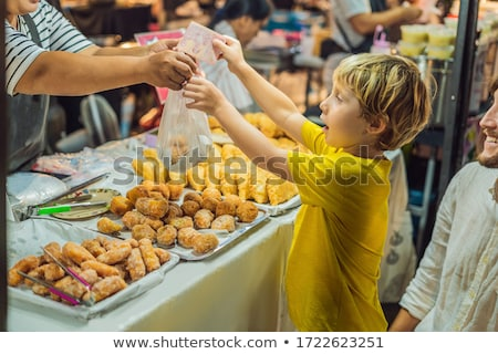 Dad and son are tourists on Walking street Asian food market Stock photo © galitskaya