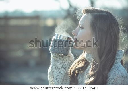 Genç kadın içecekler kahve sabah balkon büyük Stok fotoğraf © galitskaya