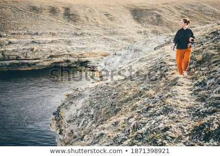 female relaxed morning walks along the beach stock photo © lovleah