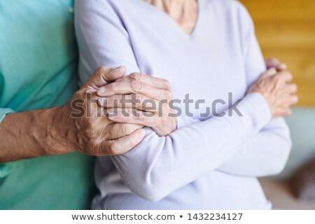 Olgun kadın el ele tutuşarak aşk koca her ikisi de Stok fotoğraf © pressmaster