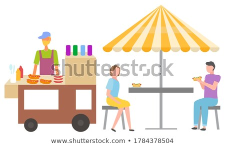 Hot Dog Seller with Buns, People Eating in Shade Stock photo © robuart