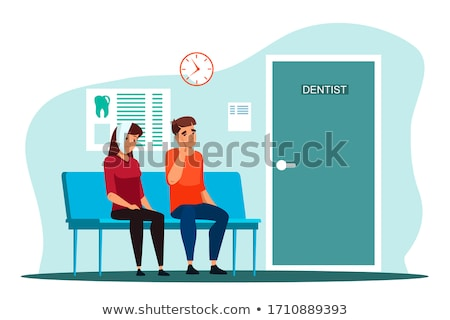 patient suffering from toothache at dental clinic Stock photo © dolgachov